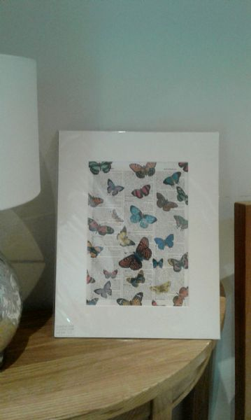 Butterflies printed on an old page